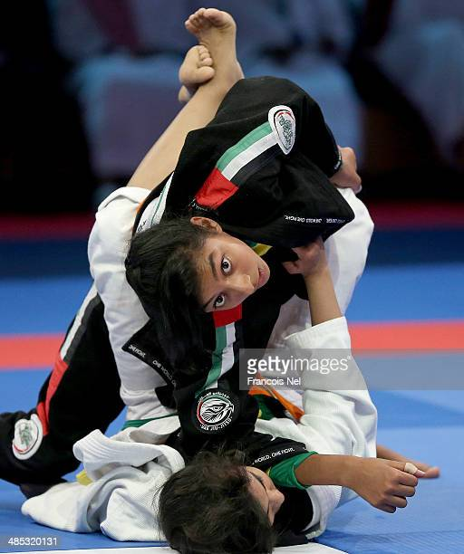 Wadima Saeed Alyafel of United Arab Emirates competes with Alyazah Khalfan Alshehyari of United Arab Emirates in the Girls Junior yellow orange belt...