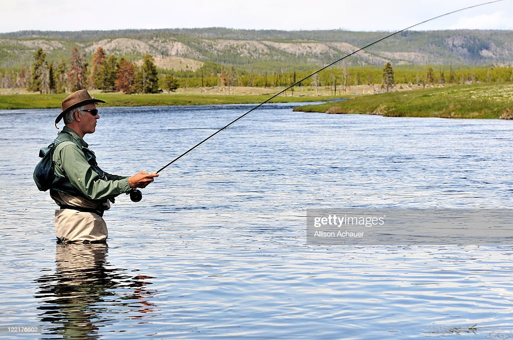 Wading fisherman : Stock Photo