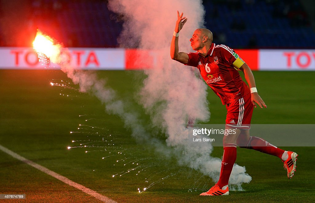 Wael Gomaa of Al Ahly throws a flare away during the FIFA Club World Cup 5th place match between Al Ahly SC and CF Monterrey at Marrakech Stadium on...