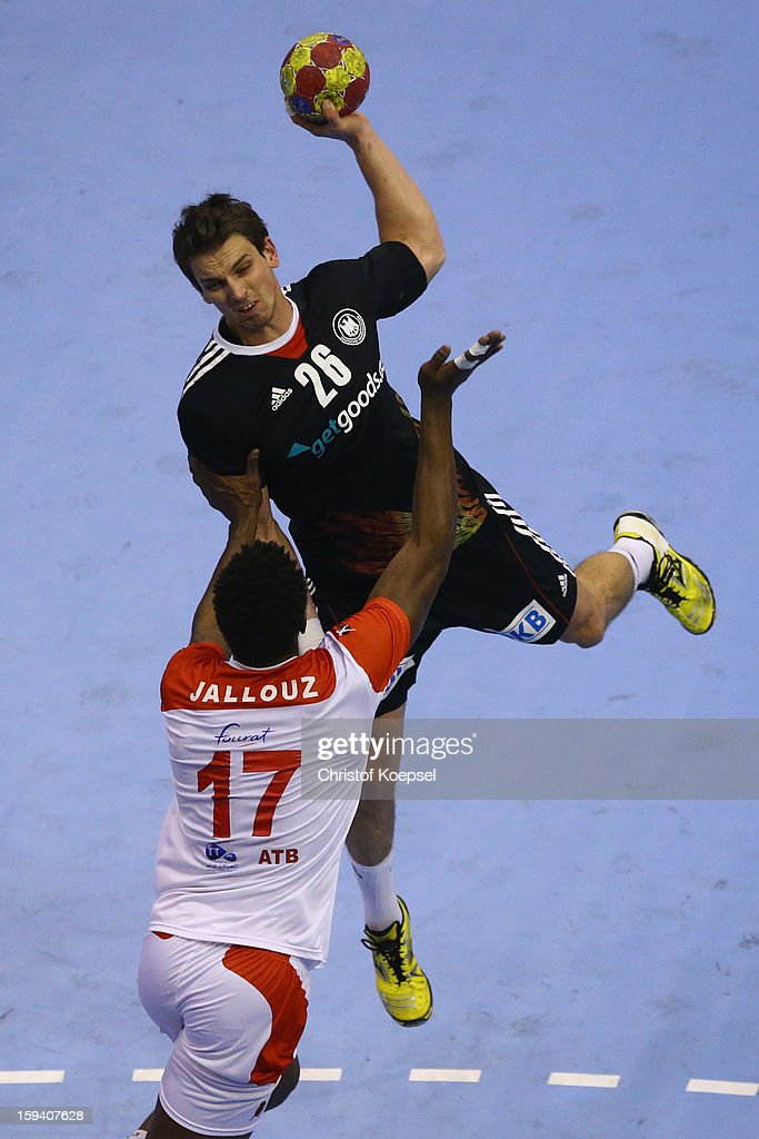 Wael Jallouz of Tunisia defends against Adrian Pfahl of Germany during the premilary group A match between Tunisia and Germany at Palacio de Deportes de Granollers on January 13, 2013 in Granollers, Spain.
