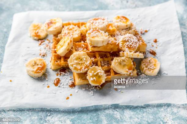 waffels with banana slices and caramel syrup