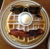 A waffle butter bacon and sunglasses resembling a humorous face
