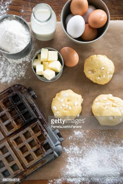 Waffle Iron, Dough, Flour, Milk, Eggs, Sugar, Butter, Parchment Paper