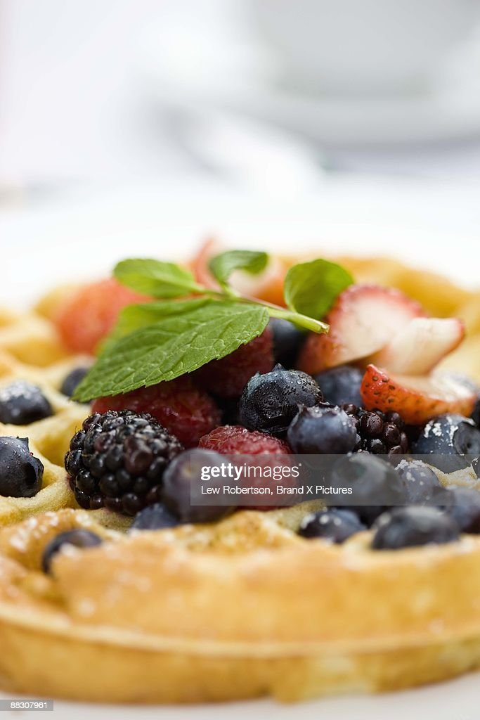 Waffle with blueberries, strawberries, and blackberries : Stock Photo