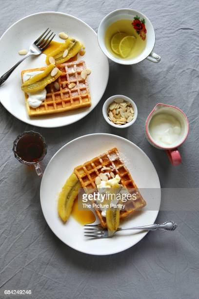 Waffles with caramelized bananas,yogurt and toasted almond flakes.Top view