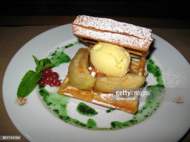 Waffles with carmelized apple and vanilla ice cream