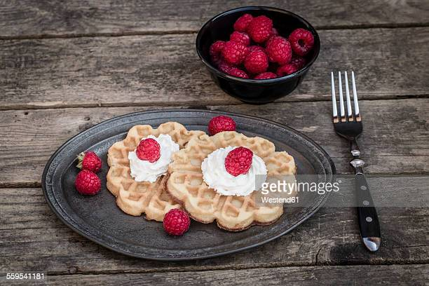 Waffles with raspberries and whiped cream