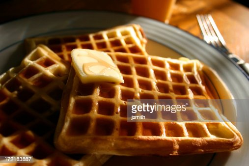 Waffles with syrup and butter on plate