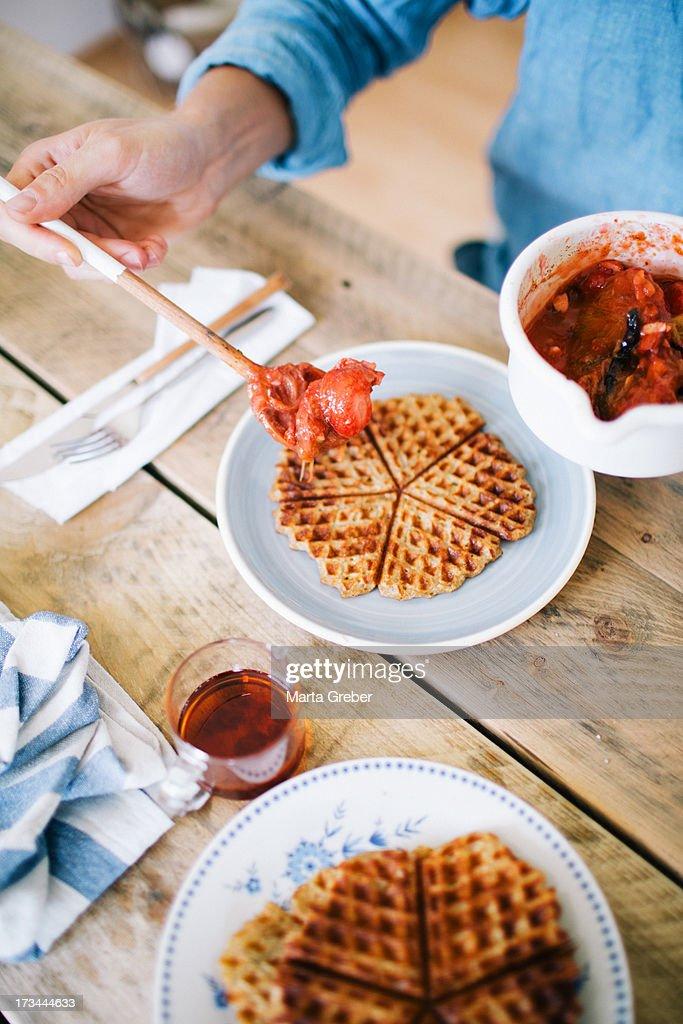 Waffles with vanilla rhubarb strawberry sauce : Stock Photo