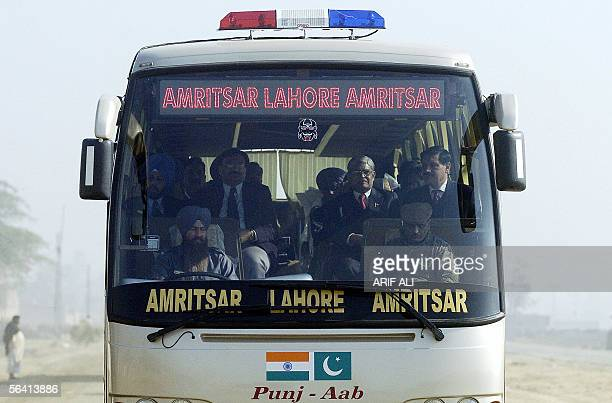 A bus carrying Indian and Pakistani officials and coming from Amritsar in India's northern state of Punjab makes its way in Pakistani Punjab after it...