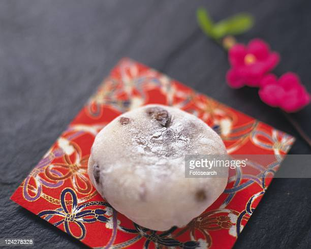 Wagashi called daihuku on Japanese paper, high angle view, Differential Focus