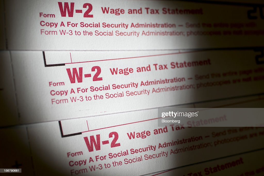 W-2 wage and tax statement forms are arranged for a photograph in Washington, D.C., U.S., on Tuesday, Nov. 20, 2012. President Barack Obama expressed confidence that he and Congress would reach an agreement that will avoid the automatic spending cuts and tax increases that are scheduled to occur at the end of the year. The fiscal cliff is the $607 billion combination of automatic spending cuts and tax increases scheduled to take effect in January. Lawmakers are trying to avert the cliff to prevent a short-term shock to the economy and reach an agreement on long-term deficit reduction. Photographer: Andrew Harrer/Bloomberg via Getty Images