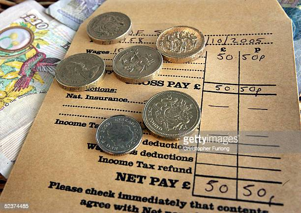 A wage packet and money is seen on March 11 2005 in Glasgow Scotland As of October 2005 the UK minimum wage will be raised to GBP505 from GBP485...