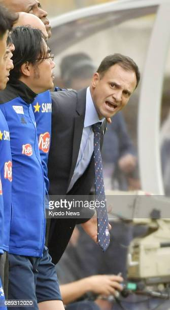 Wagner Lopes new manager of JLeague firstdivision club Albirex Niigata shouts instructions to his players before the start of the second half of a...