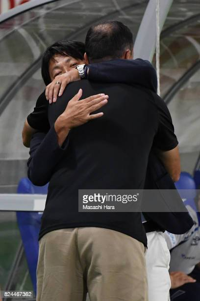 Wagner Lopescoach of Albirex Niigata hugs with Yoshiyuki Shinoda coach of FC Tokyo prior to the JLeague J1 match between FC Tokyo and Albirex Niigata...