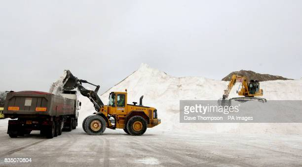A wagon is loaded with low grade salt from British Salt in Middlewich Cheshire as more snow is expected later today in some parts of the UK