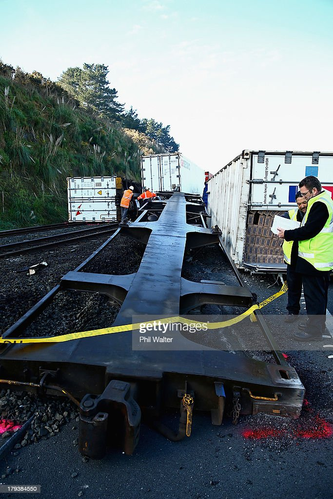 A wagon lies on its side after derailing near Mercer on September 3, 2013 in Auckland, New Zealand. The train derailed early this morning and partially blocked state highway 1. There have been no reports of injuries and a crane has been called in to clear up the debris.