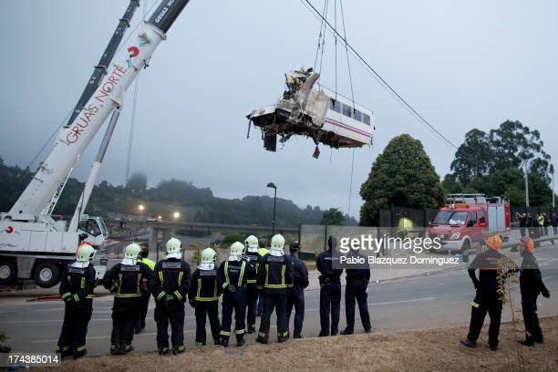 A wagon of a crashed train that killed at least 77 people is lifted on July 25 2013 at Angrois near Santiago de Compostela Spain The crash occurred...