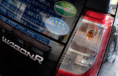 A Wagon R compact car manufactured by Japanese automaker Suzuki Motor is displayed at a retail store in Tokyo on May 18 2016 Suzuki Motor on May 18...