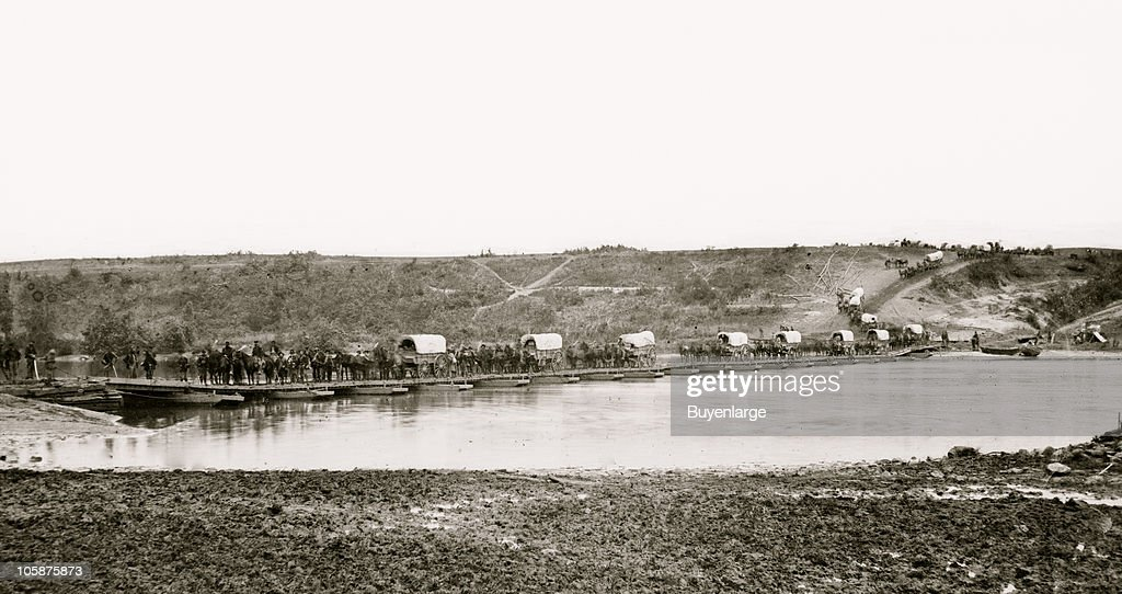 Wagons and horses crossing a pontoon bridge across the Rappahannock Fredericksburg VA 1863