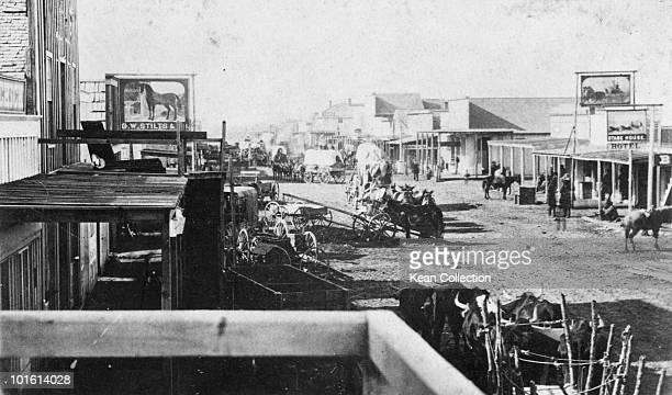 Wagons arriving in a new town in the American west circa 1870