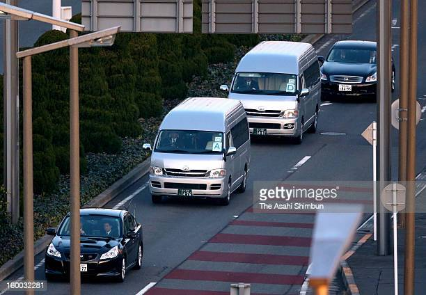 Wagons believed to carry the survivors of the Algerian hostage crisis leave Tokyo International Airport on January 25 2013 in Tokyo Japan A Japanese...
