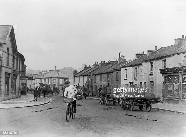 Wagons loaded with apples in a street in Newton Abbot Devon October 1908