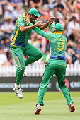 Wahab Riaz and Imad Waseem of Pakistan celebrate the wicket of Martin Guptill of New Zealand during the One Day International match between New...