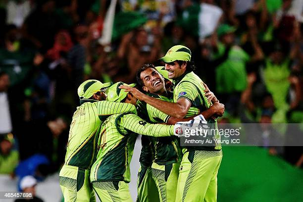 Wahab Riaz of Pakistan and the team celebrate the wicket of Mohammad Imran Tahir of South Africa to win the match during the 2015 ICC Cricket World...