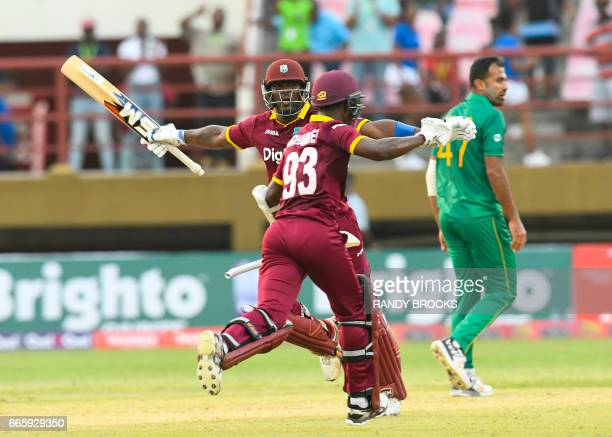 Wahab Riaz of Pakistan walks off the field as Ashley Nurse and Jason Mohammed of West Indies celebrate winning the 1st ODI match between West Indies...