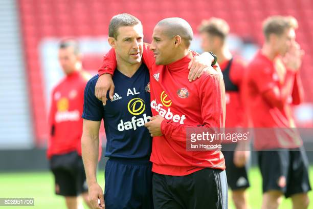 Wahbi Khazri chats with staff member Adrian Lamb during a Sunderland training session at Stadium of Light on July 28 2017 in Sunderland England