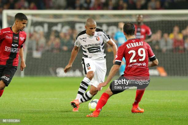 Wahbi Khazri of Rennes and Christophe Kerbrat of Guingamp during the Ligue 1 match between EA Guingamp and Stade Rennais at Stade du Roudourou on...