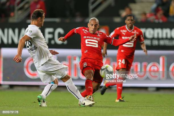Wahbi Khazri of Rennes and Damien Da Silva of Caen during the Ligue 1 match between Stade Rennais and SM Caen at Roazhon Park on September 30 2017 in...