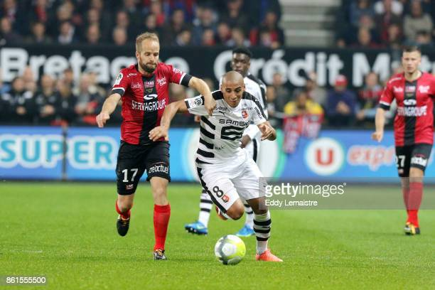 Wahbi Khazri of Rennes and Etienne Didot of Guingamp during the Ligue 1 match between EA Guingamp and Stade Rennais at Stade du Roudourou on October...