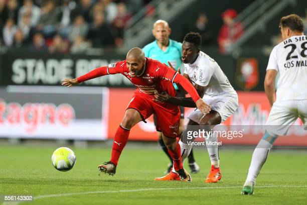 Wahbi Khazri of Rennes and Romain Genevois of Caen during the Ligue 1 match between Stade Rennais and SM Caen at Roazhon Park on September 30 2017 in...