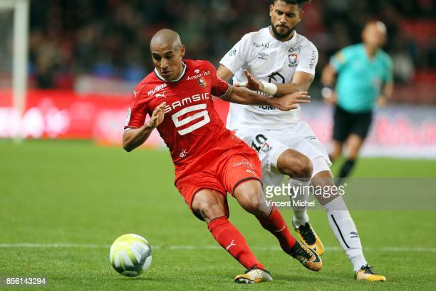 Wahbi Khazri of Rennes and Youssef Ait Benasser of Caen during the Ligue 1 match between Stade Rennais and SM Caen at Roazhon Park on September 30...