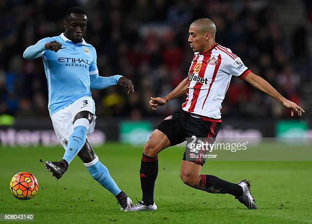 Wahbi Khazri of Sunderland and Bacary Sagna of Manchester City compete for the ball during the Barclays Premier League match between Sunderland and...