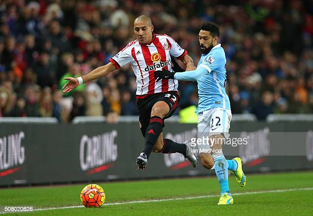 Wahbi Khazri of Sunderland and Gael Clichy of Manchester City compete for the ball during the Barclays Premier League match between Sunderland and...
