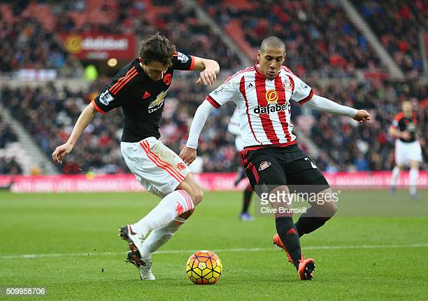 Wahbi Khazri of Sunderland and Matteo Darmian of Manchester United compete for the ball during the Barclays Premier League match between Sunderland...