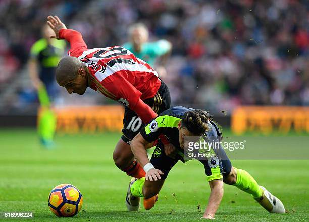 Wahbi Khazri of Sunderland and Mesut Ozil of Arsenal battle for possession during the Premier League match between Sunderland and Arsenal at the...