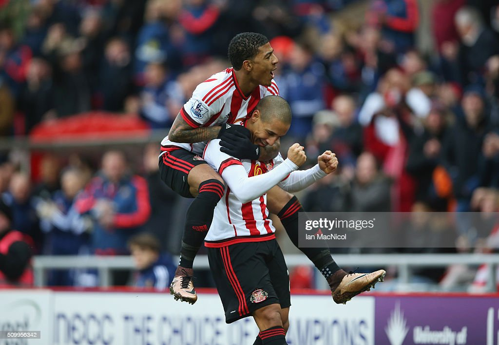 Wahbi Khazri (R) of Sunderland celebrates scoring his team's first goal with his team mate <a gi-track='captionPersonalityLinkClicked' href=/galleries/search?phrase=Patrick+van+Aanholt&family=editorial&specificpeople=3542425 ng-click='$event.stopPropagation()'>Patrick van Aanholt</a> (L) during the Barclays Premier League match between Sunderland and Manchester United at the Stadium of Light on February 13, 2016 in Sunderland, England.