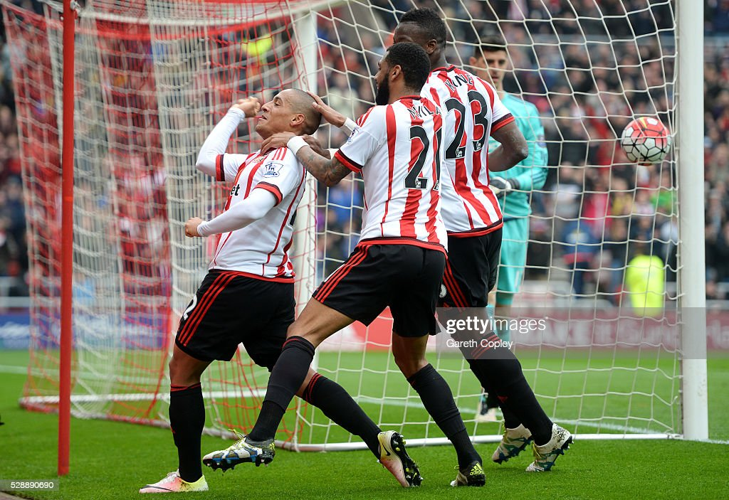 Wahbi Khazri (L) of Sunderland celebrates scoring his team's first goal with his team mates Yann M'Vila (C) and Lamine Kone (R) during the Barclays Premier League match between Sunderland and Chelsea at the Stadium of Light on May 7, 2016 in Sunderland, United Kingdom.