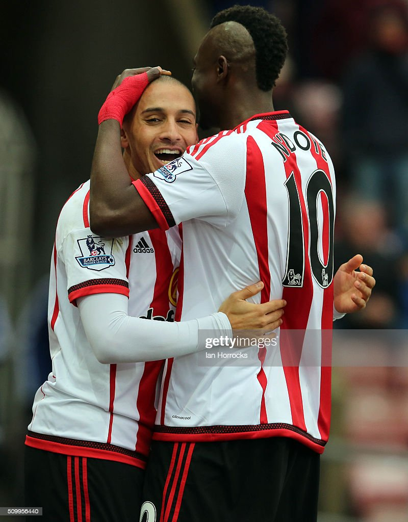 Wahbi Khazri of Sunderland (L) celebrates the first goal with Dame N'Doye during the Barclays Premier match between Sunderland and Manchester United at the Stadium of Light on February 13, 2016 in Sunderland, England.