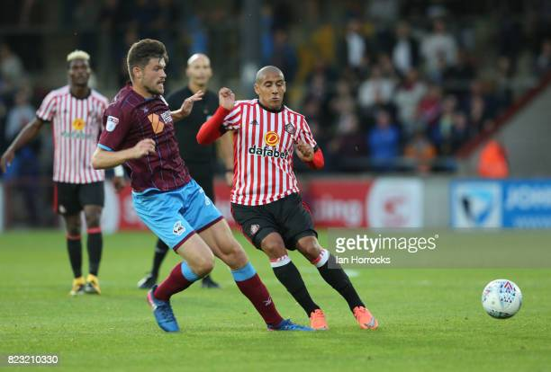 Wahbi Khazri of Sunderland challenges Cameron Burgess of Scunthorpe during a preseason friendly match between Scunthorpe United and Sunderland AFC at...