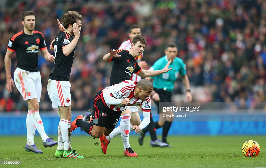 Wahbi Khazri of Sunderland is challenged by Donald Love of Manchester United during the Barclays Premier League match between Sunderland and Manchester United at the Stadium of Light on February 13, 2016 in Sunderland, England.