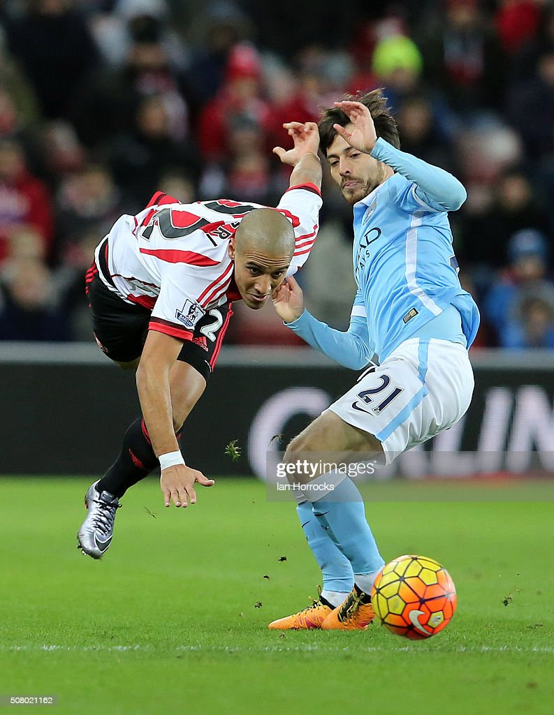 Wahbi Khazri of Sunderland (L) is takled by David Silva of Manchester City during the Barclays Premier League match between Sunderland and Manchester City at The Stadium of Light on February 02, 2016 in Sunderland, England.