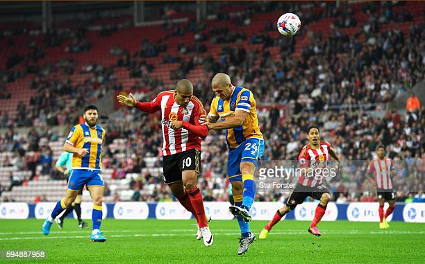 Wahbi Khazri of Sunderland jumps with Adam ElAbd of Shrewsbury Town as the header goes wide during the EFL Cup second round match between Sunderland...