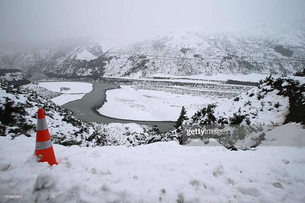 Waiau River bed is covered in snow in the Lewis Pass on June 21, 2013 in Christchurch, New Zealand. Now, sleet, rain and heavy winds have hit the region causing power outages, some flooding and bringing trees down.
