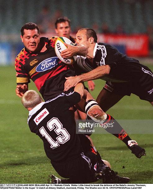 Waikato Chiefs Walter Little triesd to break the defence of the Natal's Jeremy rThomsonleftand Pieter Muller in the Super 12 match at Albany Stadium...
