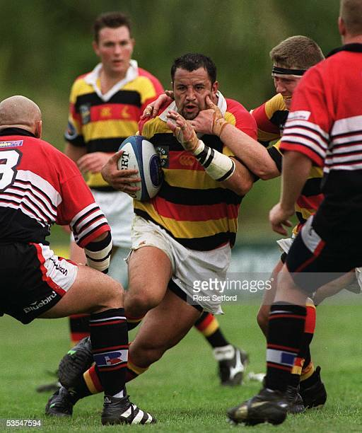 Waikato's Deon Muir receives a facial from team mate Paul Martin as he tries to break the Counties Manukau defence in the Air New Zealand 1st...